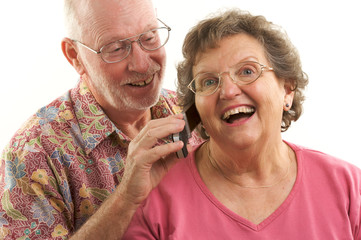 Laughing Senior Couple on Cell Phone