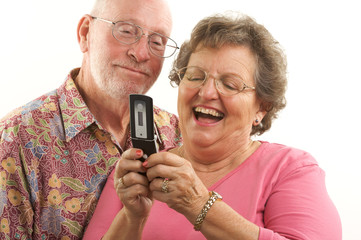 Joyful Senior Couple and Cell Phone