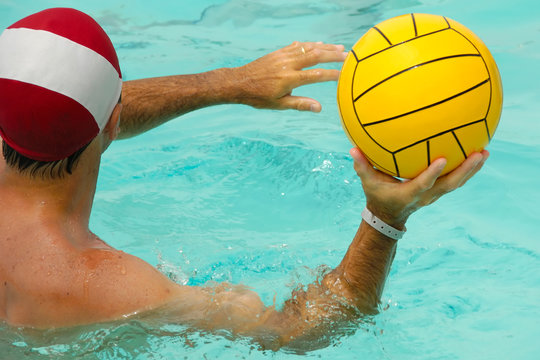 Man is playing water polo