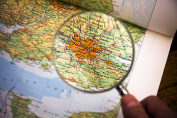 Magnifying glass over a map showing london