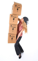 Woman with cardboard boxes ready to fall