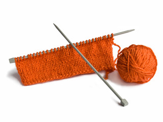Thread and a spoke for knitting on a white background