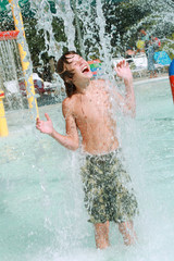 Boy playing in water at a waterpark
