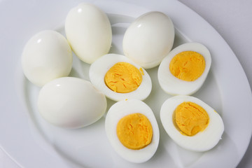 Boiled peeled eggs, two cut in half