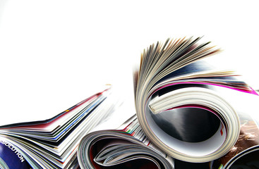 Stack of rolled up magazines, on white