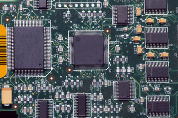 Close-up on a microchip on a scheme background