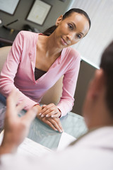 Woman having meeting with doctor in IVF clinic