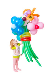 little girl with large balloons
