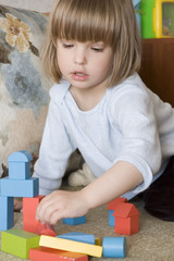 child plays with toy block