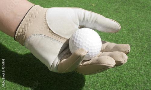 balle de golf dans la main photo libre de droits sur la. Black Bedroom Furniture Sets. Home Design Ideas