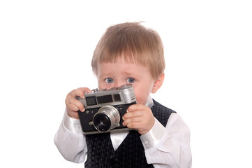 child plays the photographer