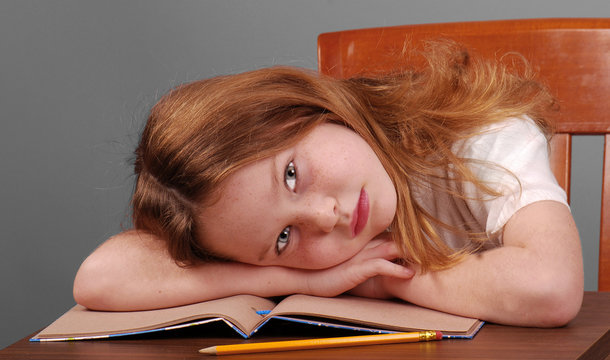 Girl Laying Down Head on Desk