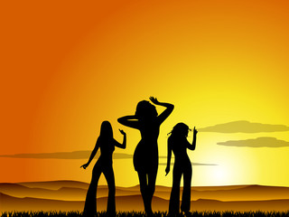 Dancing girls at sunset