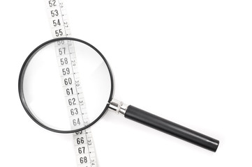 Magnifying glass and tape measure