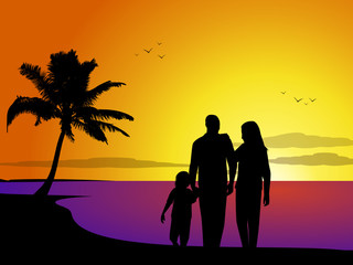 Family on a tropical beach at sunset