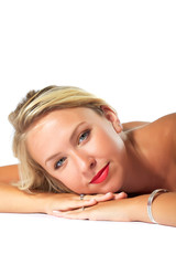 Pretty Blond laying down on white background