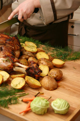 Chef cooked roasted meat and vegetables