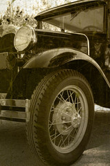 Antique automobile in grunge distressed image