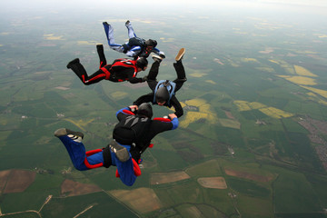 Four Skydiver building a formation