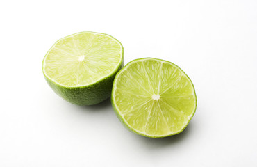 a lime cut in two on a white background