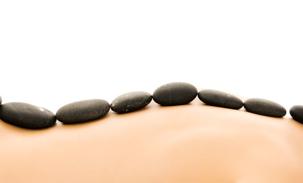 Massage with hot stones