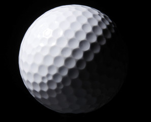 White Golf Ball on black background