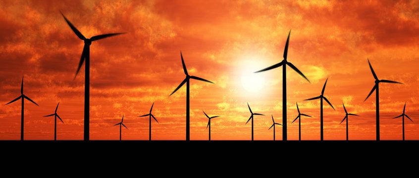 Wind generators over orange sky
