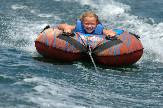 Girl Water Tubing with a Smile