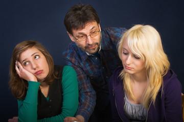 teacher explaining the lesson to schoolgirls
