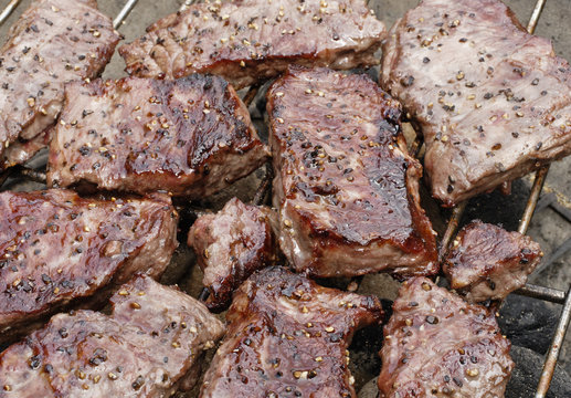 steaks on Barbecue grill top view