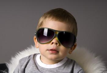 Little Boy in big glasses.