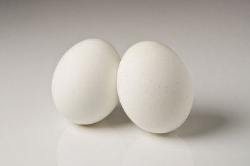 two eggs against white