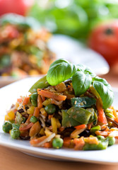 Fresh red vegetable salad with corn and basil