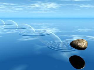 pierre rond sur l'eau