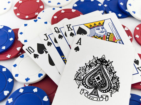 Red White and Blue Poker Chips and Royal Flush on White Backgrou