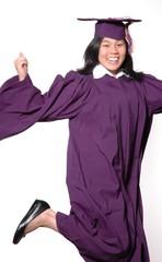 jumping graduating young woman
