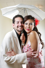 Happy smiling young couple under umbrella