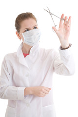 The young nurse with scissors isolated on a white
