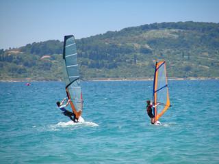 Small and big windsurfer