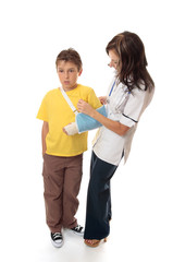 Nurse assisting an injured boy