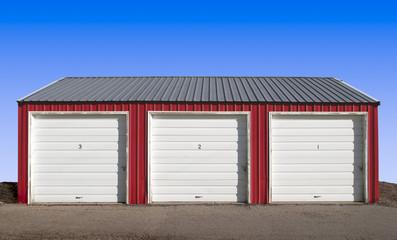 Three Storage Locker Doors with a Blue Sky Background