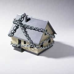 Miniature house with chains