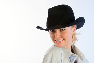 Portrait of young woman in a hat
