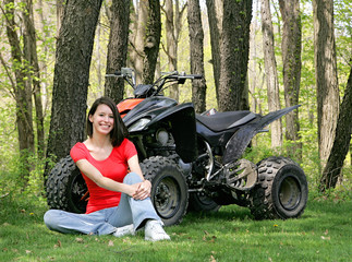 woman sitting with ATV
