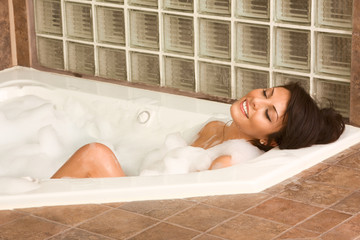 Attractive young gorges woman taking bath