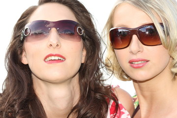 Pretty girls looking cool with sunglasses