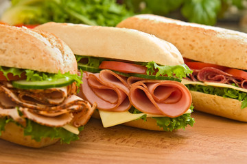 Photo on textile frame Snack Ham sandwich, turkey sandwich and salami sandwich