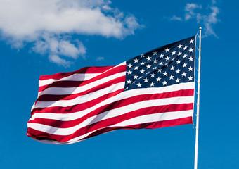 american flag over blue sky background