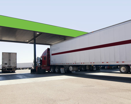 Truck at fuel stop off highway.