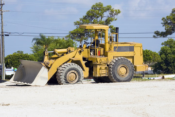 A front-end loader with a flat tire